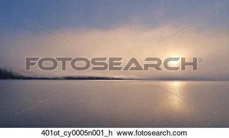Stock Photo of A foggy sunrise over Lake Whatcom during Winter.
