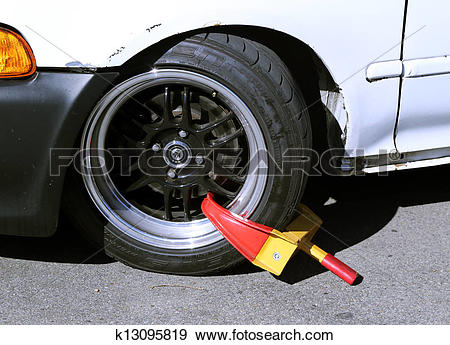 Stock Photograph of Wheel lock on illegally parked car k13095819.
