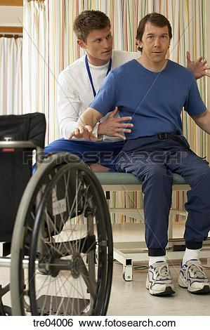 Stock Images of Physical therapist helping wheelchair.