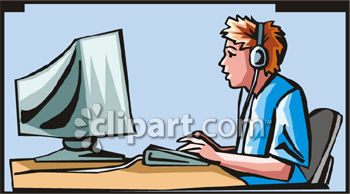 Boy Wearing Headphones While Working On A Computer.