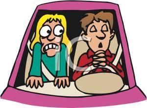 Scared Girl Watching a Boy Praying While Driving.