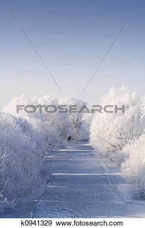 Stock Photograph of Frozen river with white frost trees k0941329.