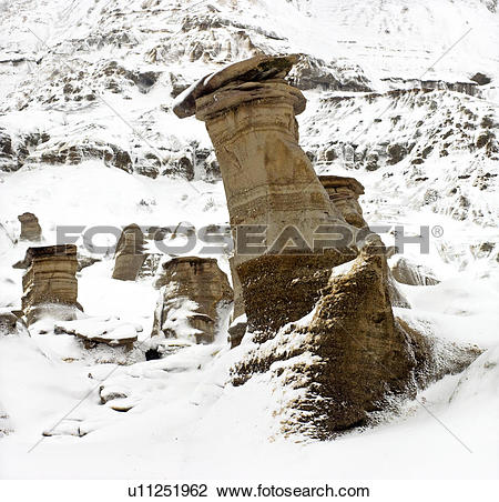 Stock Photo of Fresh snow on badlands and hoodoo formations.