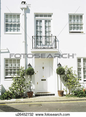 Stock Photo of Balcony above white front door of modern white.