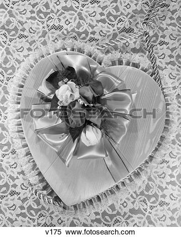 Stock Image of Fancy Valentine Heart Box Covered With Satin Ribbon.