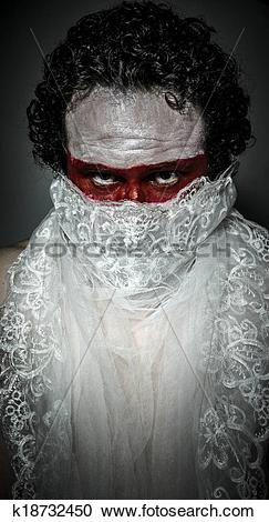 Stock Photography of man covered with white lace veil, mask of red.