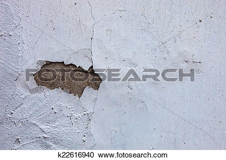 Stock Photography of Whitewashed wall with the hole in the cracked.