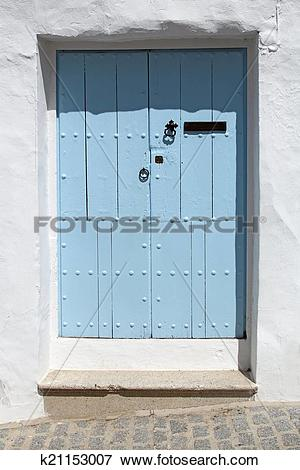 Picture of wooden blue door and whitewashed wall k21153007.