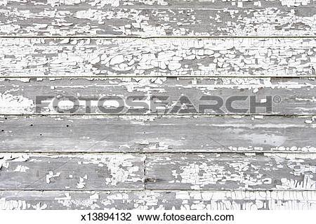 Stock Photo of Paint peeling off white washed fence, close.