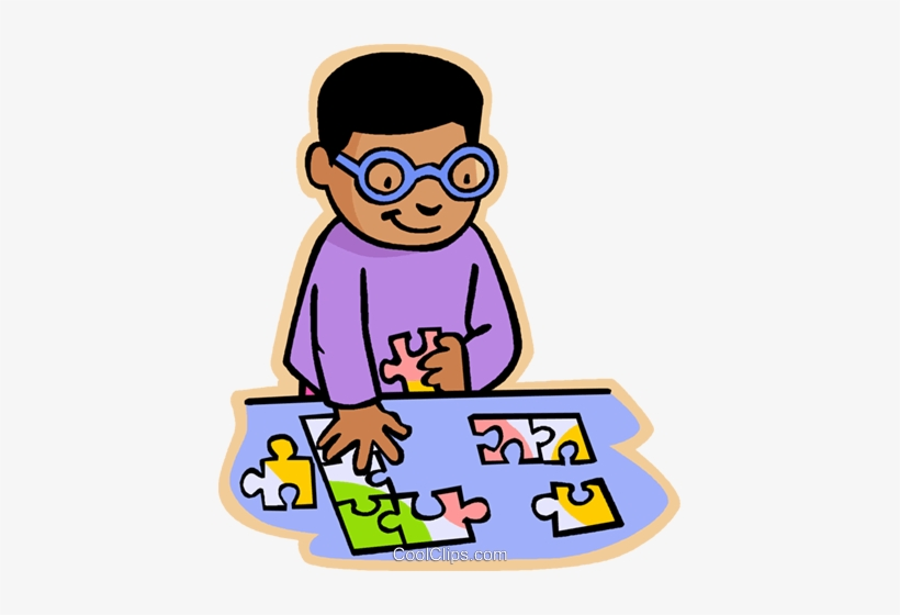 Children At Play, Kids, Boy Doing Puzzle Royalty Free.