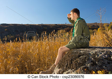 Picture of Young Boy Scout on Rock Watching Wide Field.