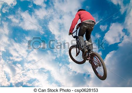 Stock Photos of Bike rider high jump.