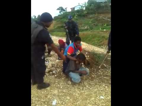 Police Brutality in Papua New Guinea (Beating, kicking women & men).