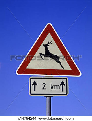 Stock Photo of road sign, wild animal crossing, next 2 km.