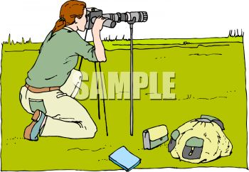 Wildlife Photographer Shooting with a Telescopic Lens.
