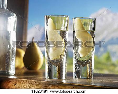 Stock Photography of Two glasses of William's pear schnapps.