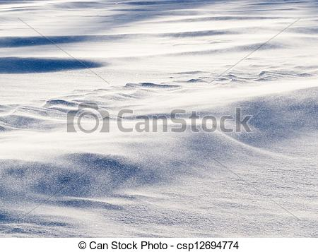 Picture of Wind drift snow flying over snow surface refief.