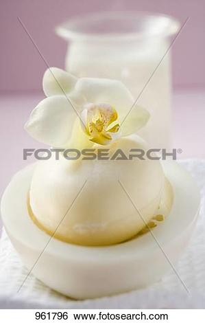 Stock Images of Perfumed soap in soap dish, towel and windlight.