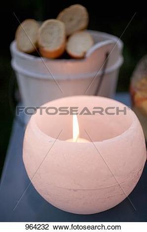 Stock Photo of Windlight on table in garden 964232.