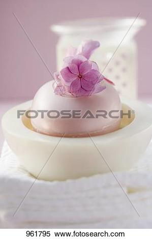 Stock Image of Perfumed soap in soap dish, towels and windlight.
