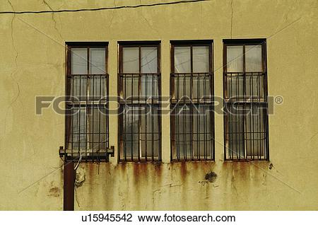 Stock Photo of Iron Window Bars on Windows u15945542.