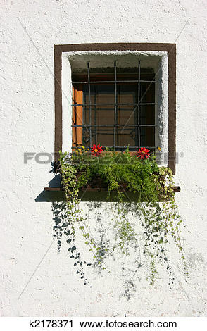 Stock Photography of Window, bars and white wall k2178371.