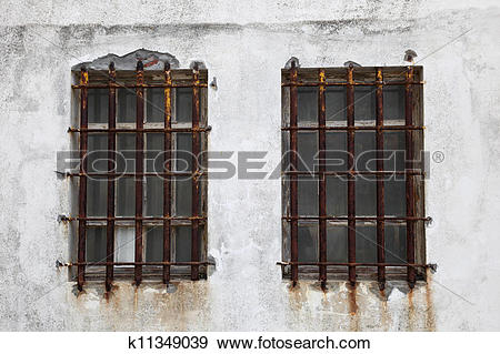 Stock Photograph of Rusted iron window bars k11349039.