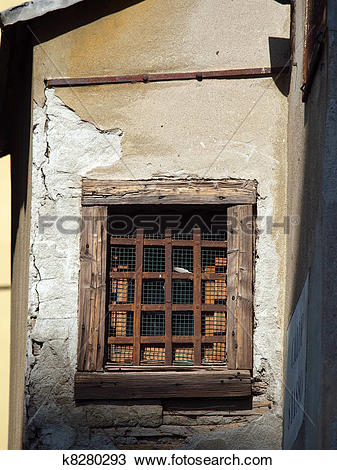 Stock Photo of Old window with metal grating k8280293.