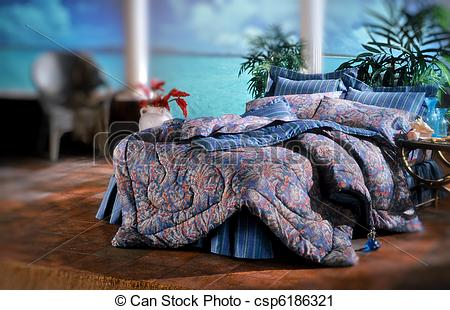 Stock Photography of Bed room set with bedding and window light.