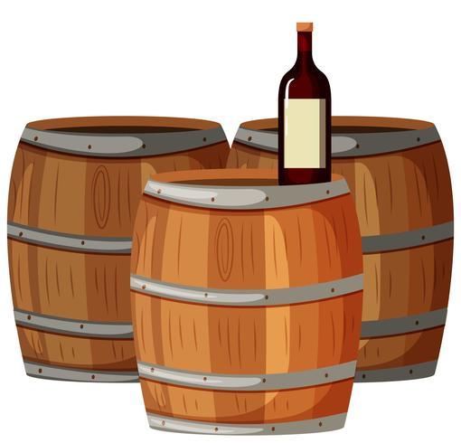 Wine bottle on wooden barrels.
