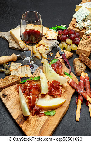 Cold meat cheese plate with salami chorizo sausage, prosciutto, cheese and  wine.