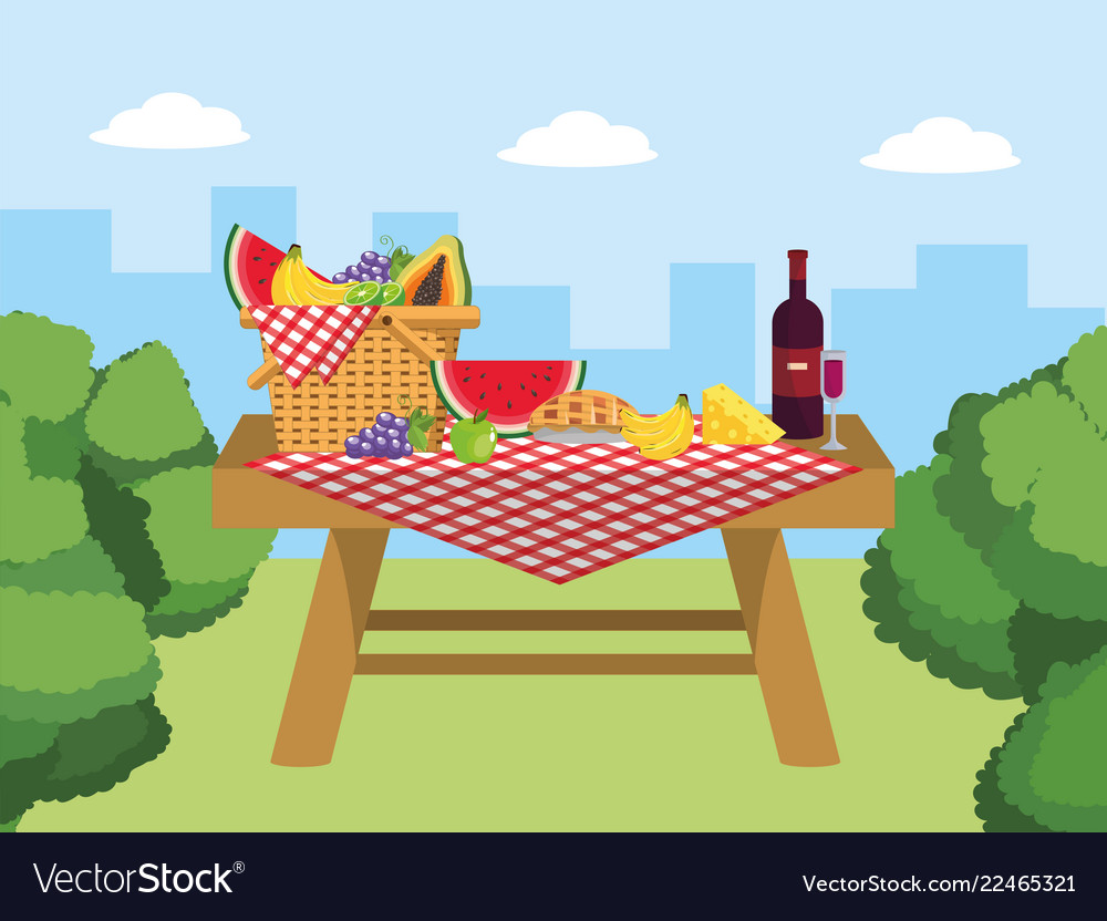 Basket in the table with wine and cheese food.