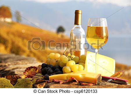 Stock Photos of Glass of white wine and chesse on the terrace.