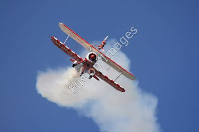 Stock Photography of a Wingwalker on Flying Plane.