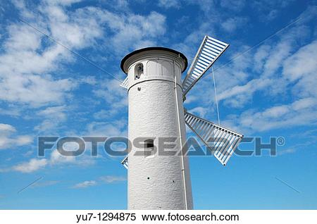 Stock Image of Beacon ?Windmill? on stone pier next to port entry.