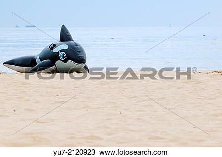 Stock Photo of Inflatable orca on the beach in Swinoujscie at.