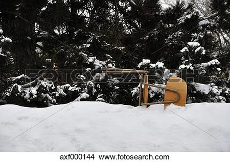 Stock Photo of Germany, Bavaria, Fallen office chair in snow with.