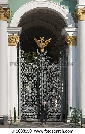 Stock Photography of Security officer standing in front of a gate.