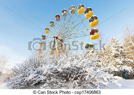 Stock Image of Winter panorama of abandoned Ferris wheel.