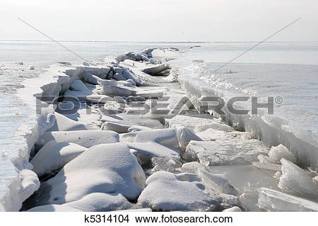 Stock Photo of frozen Winter sea, the crack in the ice k5314104.