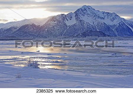 Stock Image of A late winter sunrise over Pioneer Peak; Palmer.