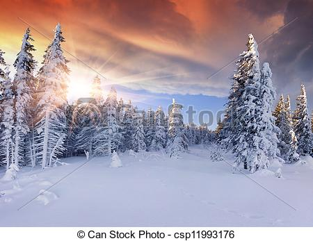 Picture of Beautiful winter sunrise in the mountains. Dramatic red.