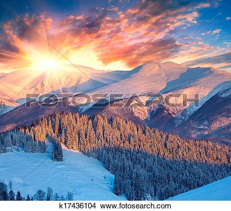 Stock Photo of Colorful winter sunrise in mountains. k17436104.