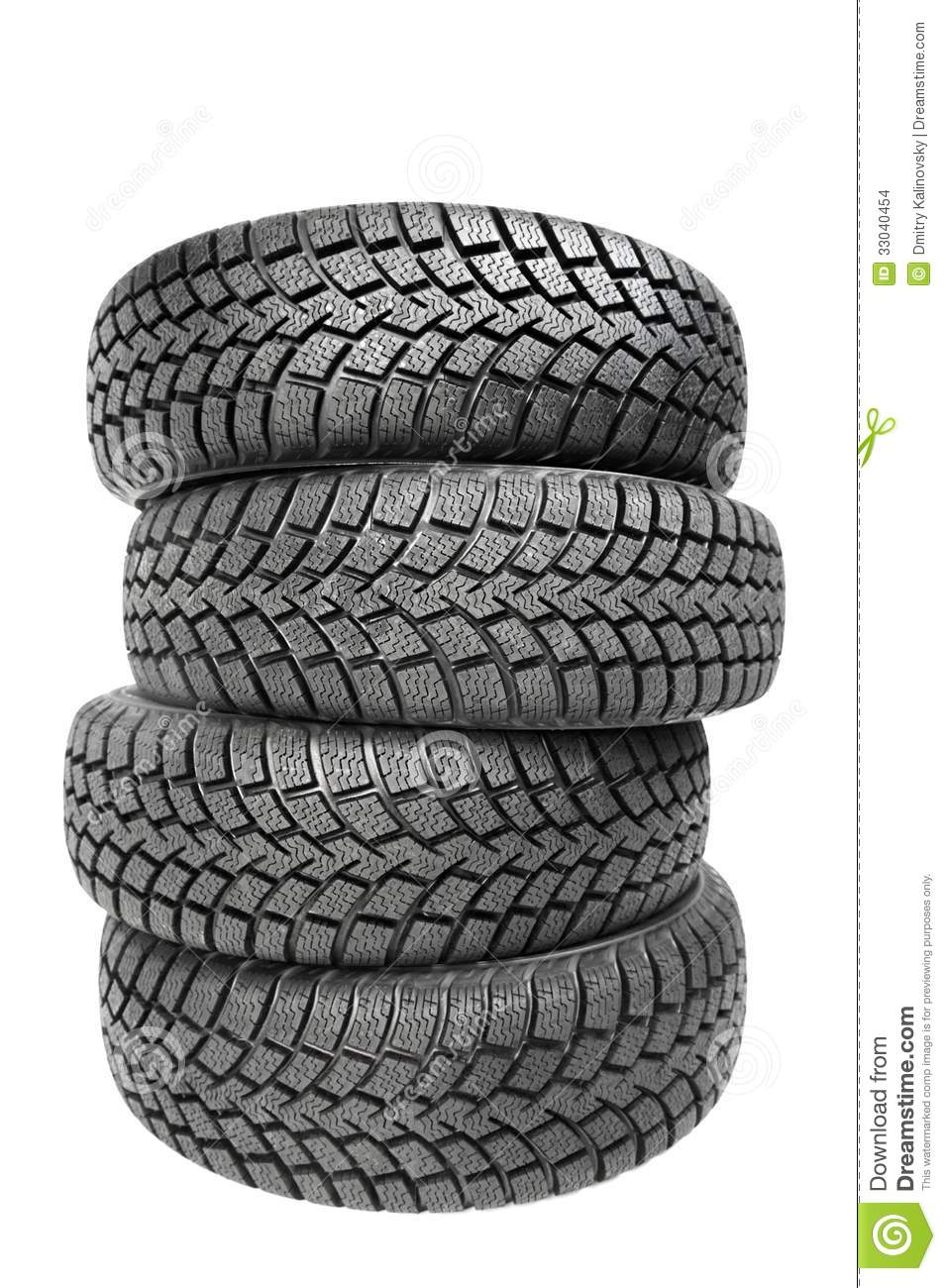 Stack Of Four Car Wheel Winter Tires Isolated Stock Images.