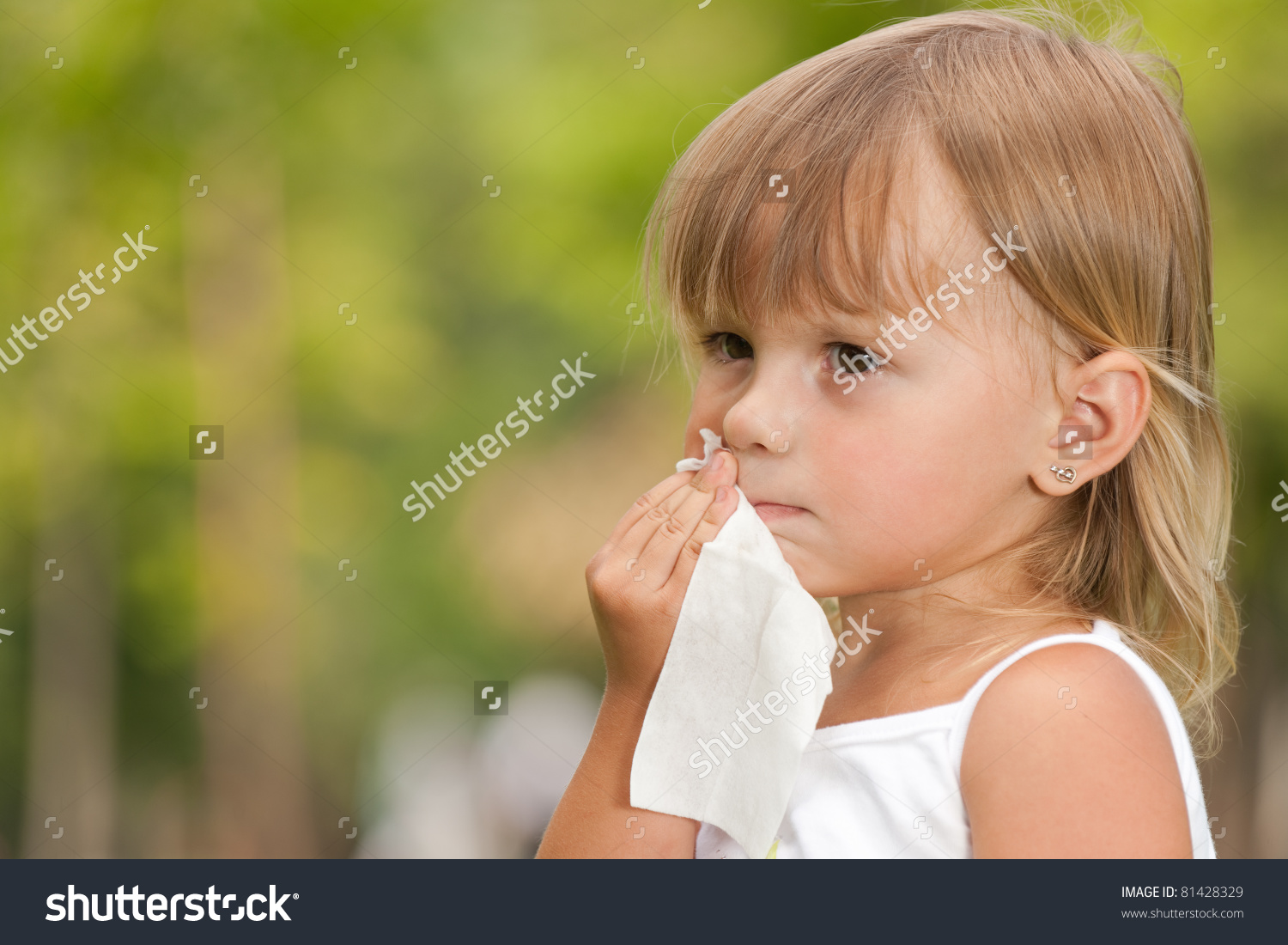 A Serious Little Girl Is Wipes A Mouth After Meal Stock Photo.