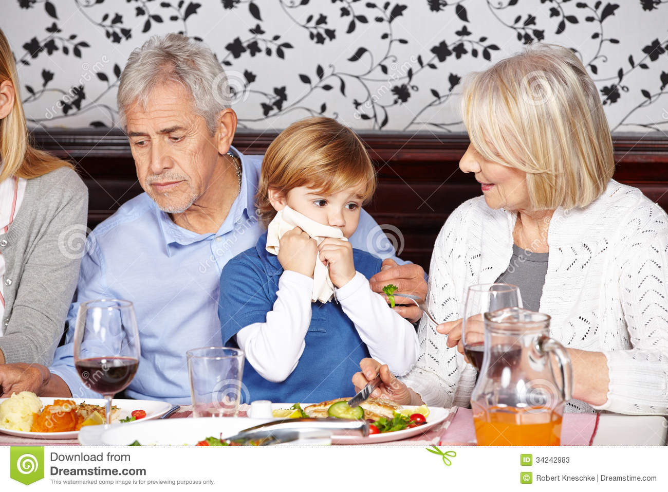 Child Cleaning Mouth With Napkin Stock Photos.