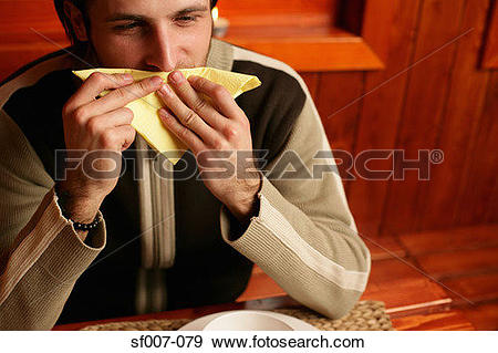 Stock Photograph of Man wiping his mouth with napkin sf007.
