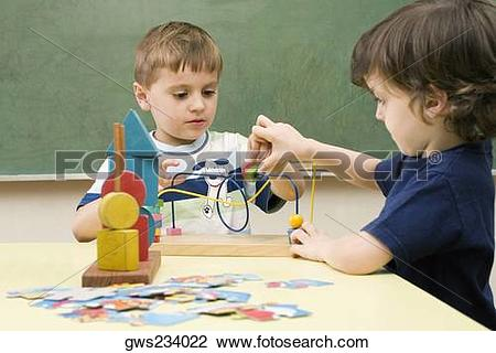 Stock Photo of Two boys playing with a buzz wire game gws234022.
