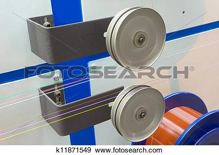 Stock Photograph of Metal wire coil with optical fiber in colored.