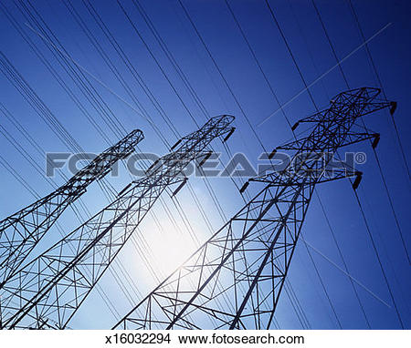 Stock Photo of low angle view of high tension cable towers.